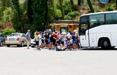 OLIMPIA, GREECE - JUNE 10: The group of tourists buying tickets for visit of ancient Olympia on June 10, 2013 in Olympia, Greece. Up to 16 mln tourists is expected to visit Greece in year 2013.