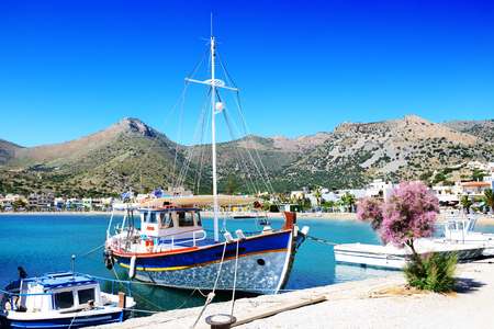 The traditional Greek fishing boat near pier, Crete, Greece photo