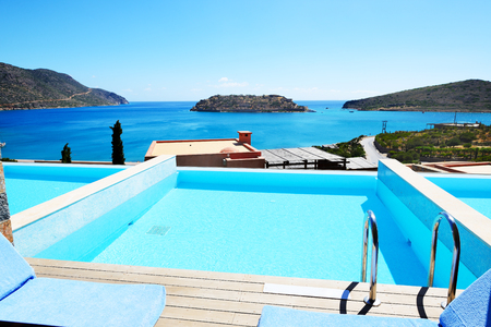 Swimming pool at luxury hotel with a view on Spinalonga Island, Crete, Greece