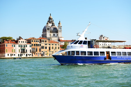 VENICE, ITALY - JUNE 16  The passenger ship with tourists is on water channel on June 16, 2014 in Venice, Italy  More then 46 mln tourists is expected to visit Italy in year 2014