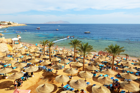 SHARM EL SHEIKH, EGYPT -  NOVEMBER 30: The tourists are on vacation at popular hotel on November 30, 2013 in Sharm el Sheikh, Egypt. Up to 12 million tourists have visited Egypt in year 2013. Editorial