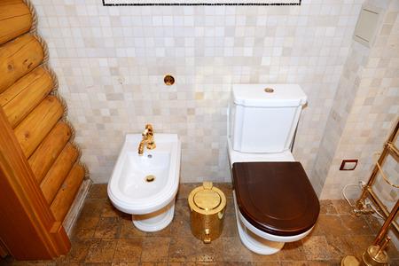 NOVI PETRIVTSI, UKRAINE - OCTOBER 14: The Golden saunas toilet interior in Mezhigirya on October 14, 2014 in Novi Petrivtsi, Ukraine. It is former residence of ex-president Yanukovich, now open to the public