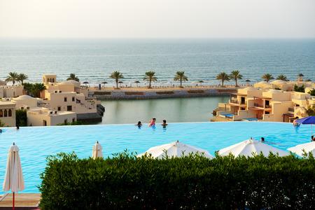 khaima: RAS AL KHAIMAH, UAE - SEPTEMBER 7: The tourists enjoying their vacation at luxury hotel on September 7, 2013 Ras Al Khaimah, UAE. Up to 10 million tourists have visited UAE  in year 2013. Editorial