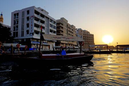 cheapest: DUBAI, UAE - SEPTEMBER 10: The traditional Abra boat in Dubai Creek on September 10, 2013 in Dubai, United Arab Emirates. The Abra is cheapest transport in Dubai Editorial