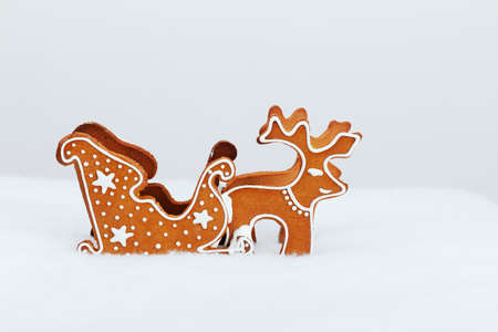 The hand-made eatable reindeer and cart with snow decoration photo