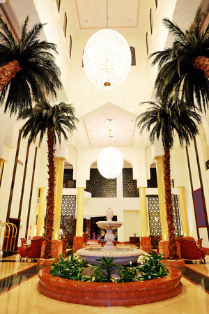 Lobby interior of the luxury hotel in night illumination, Ajman, UAE