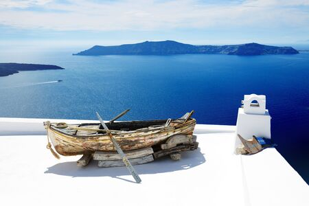 expected: FIRA, GREECE - MAY 17: The view on building decoration in Fira town on May 17, 2014 in Fira, Greece. Up to 16 mln tourists is expected to visit Greece in year 2014. Editorial