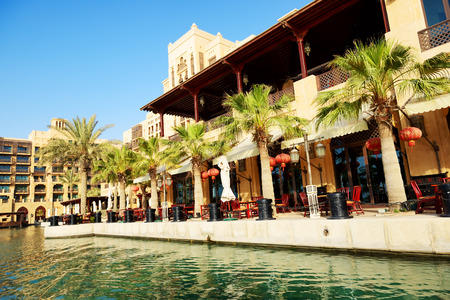 windtower: DUBAI, UAE - SEPTEMBER 9: View of the Souk Madinat Jumeirah. Madinat Jumeirah encompasses two hotels and clusters of 29 traditional Arabic houses on September 9, 2013 in Dubai, UAE Editorial