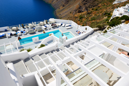 expected: OIA, GREECE - MAY 17: The tourists enjoying their vacation at luxury hotel on May 17, 2014 in Oia, Greece. Up to 16 mln tourists is expected to visit Greece in year 2014. Editorial