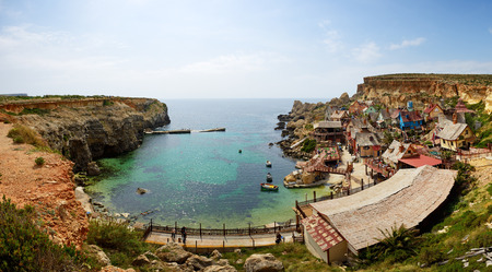 strange mountain: Popeye village is a tourists attraction in Malta Stock Photo