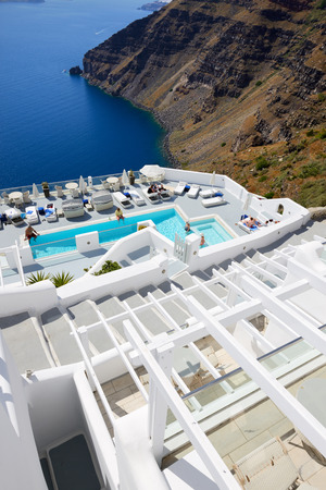 16 17: OIA, GREECE - MAY 17: The tourists enjoying their vacation at luxury hotel on May 17, 2014 in Oia, Greece. Up to 16 mln tourists is expected to visit Greece in year 2014. Editorial