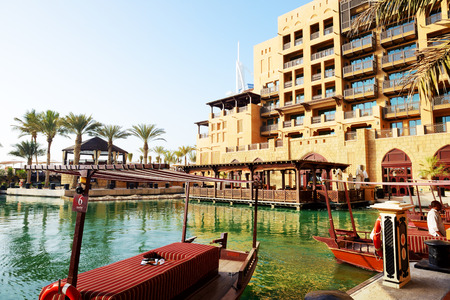 encompasses: DUBAI, UAE - SEPTEMBER 9: View of the Souk Madinat Jumeirah. Madinat Jumeirah encompasses two hotels and clusters of 29 traditional Arabic houses on September 9, 2013 in Dubai, UAE Editorial