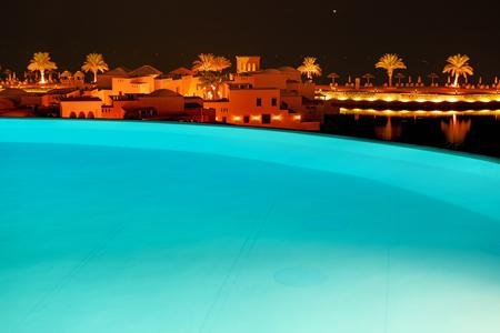 khaima: The swimming pool at luxury hotel in night illumination, Ras Al Khaima, UAE