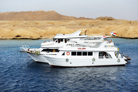 sharm el sheikh: SHARM EL SHEIKH, EGYPT -  DECEMBER 4: Snorkeling tourists and motor yachts on Red Sea in Ras Muhammad National Park. It is popular tourists destination on December 4, 2013 in Sharm el Sheikh, Egypt Editorial