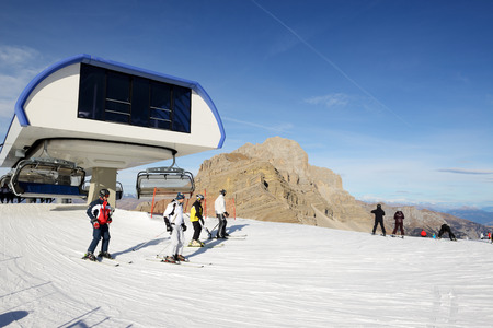 expected: MADONNA DI CAMPIGLIO, ITALY - DECEMBER 18: The ski slope and skiers at Passo Groste ski area on December 18, 2015 in Madonna di Campiglio, Italy. More then 46 mln tourists is expected to visit Italy in year 2015. Editorial