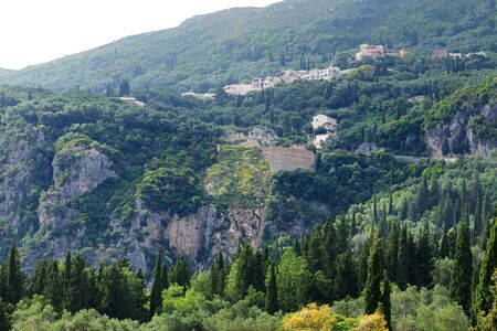 paleokastritsa: The view on mountains, cypress and olive trees in Corfu island, Greece