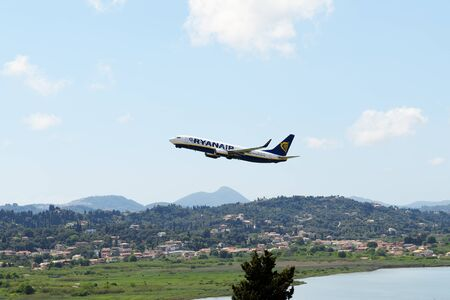 kerkyra: KERKYRA, GREEES - MAY 14: The aircraft of Ryanair Airlines taking off  in Corfu International Airport on May 14, 2016 in Kerkyra, Greece. Up to 16 mln tourists is expected to visit Greece in year 2016.