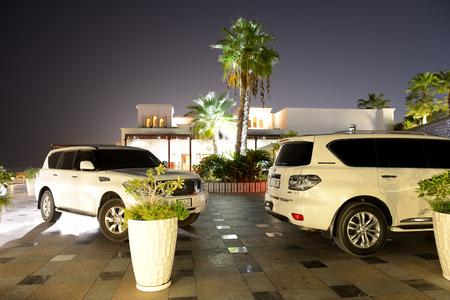 khaima: RAS AL KHAIMA, UAE - SEPTEMBER 7: The luxury off-road cars are near luxurious hotel on September 7, 2013 in Ras Al Khaima, United Arab Emirates. Up to 10 million tourists have visited UAE  in year 2013.