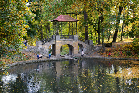 BILA TSERKVA, UKRAINE - OCTOBER 6: The Chinese Bridge in Olexandria Park and visitors on October 6, 2016 in Kerkyra, Greece. More then 12 mln tourists is expected to visit Ukraine in year 2016. Editorial