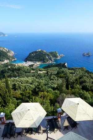 paleokastritsa: The view from restaurant on a bay in a heart shape and beach, Corfu, Greece Stock Photo