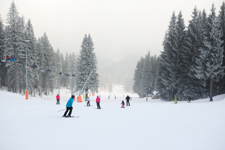 kids at the ski lift: JASNA, SLOVAKIA - JANUARY 25:  The skiers are on Biela Put slope in Jasna Low Tatras. It is the largest ski resort in Slovakia with 49 km of pistes on January 25, 2017 in Jasna, Slovakia Editorial