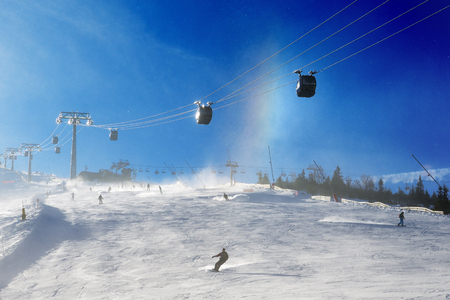 kids at the ski lift: JASNA, SLOVAKIA - JANUARY 25:  The skiers, snowborders and mountain rainbow in Jasna Low Tatras. It is the largest ski resort in Slovakia with 49 km of pistes on January 25, 2017 in Jasna, Slovakia Editorial