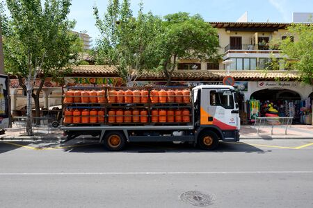 butane: MALLORCA, SPAIN - MAY 29: The track with Repsol propane bottled gas is on street on May 29, 2015 in Mallorca, Spain. Up to 60 mln tourists is expected to visit Spain in year 2015.