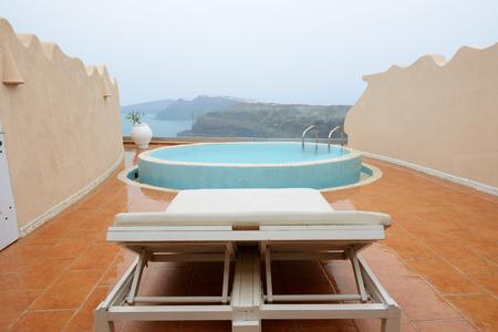 The sea view swimming pool with jacuzzi, Santorini island, Greece