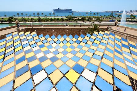 palma: The view on shore and fountain near Cathedral of Santa Maria of Palma in Palma de Mallorca, Spain Stock Photo