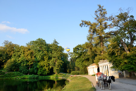 BILA TSERKVA, UKRAINE - AUGUST 27: The view on balloons are over  Olexandria Park and visitors on August 27, 2017 in Bila Tserkva, Ukraine. The balloons show is dedicated to Ukrainian Independence Day.