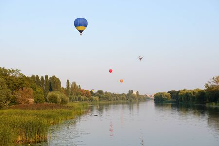 BILA TSERKVA, UKRAINE - AUGUST 26: The view on balloons are over Ros river in Bila Tserkva town on August 26, 2017 in Bila Tserkva, Ukraine. The balloons show is dedicated to Ukrainian Independence Day.