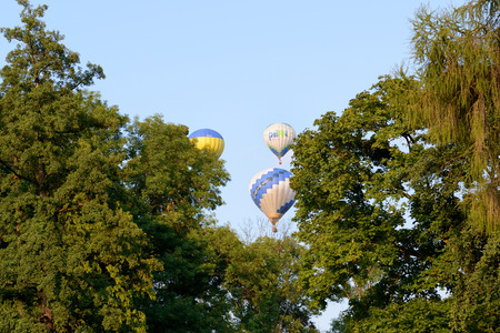 BILA TSERKVA, UKRAINE - AUGUST 27: The view on balloons are over  Olexandria Park and trees on August 27, 2017 in Bila Tserkva, Ukraine. The balloons show is dedicated to Ukrainian Independence Day.