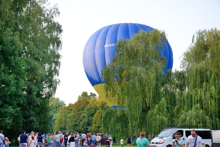 BILA TSERKVA, UKRAINE - AUGUST 26: The view on balloons are over  Olexandria Park and visitors on August 26, 2017 in Bila Tserkva, Ukraine. The balloons show is dedicated to Ukrainian Independence Day. Editorial