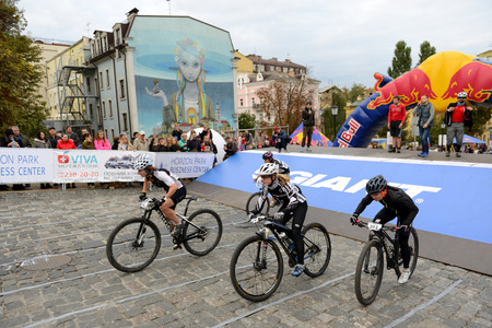 KYIV, UKRAINE - OCTOBER 7: The racers are on Red Bull Hill Chasers on October 7, 2017 in Kyiv, Ukraine. It is the uphill bike sprint race. Taking place In Kyiv on Andriyivskyy Descent Redakční