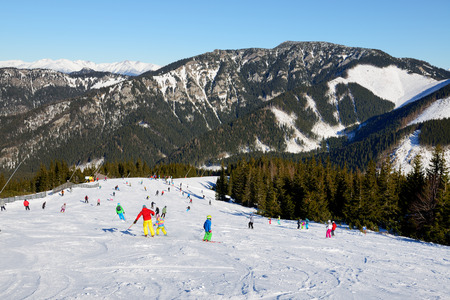 kids at the ski lift: JASNA, SLOVAKIA - JANUARY 22:  The skiers and snowborders are on slope in Jasna Low Tatras. It is the largest ski resort in Slovakia with 49 km of pistes on January 22, 2017 in Jasna, Slovakia
