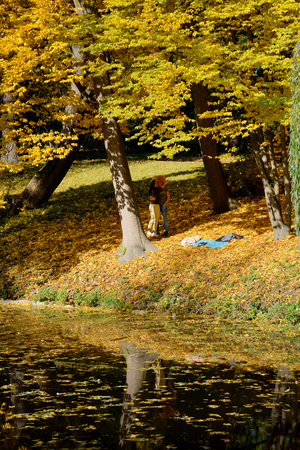 BILA TSERKVA, UKRAINE - OCTOBER 18: The visitors in Olexandria Park making selfie on October 18, 2017 in Bila Tserkva, Ukraine. More then 12 mln tourists is expected to visit Ukraine in year 2017.