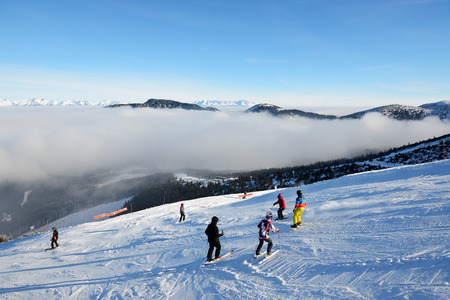 The skiers are on slope and fog in Jasna Low Tatras, Slovakia