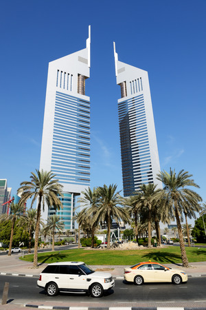 DUBAI, UAE - NOVEMBER 19: The Emirates Towers, Range Rover Sport and Taxi cars on November 19, 2017. The Emirates Towers complex is set in over 570,000 m2 Editorial