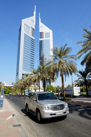 DUBAI, UAE - NOVEMBER 19: The Emirates Towers and Land Cruiser car on November 19, 2017. The Emirates Towers complex is set in over 570,000 m2