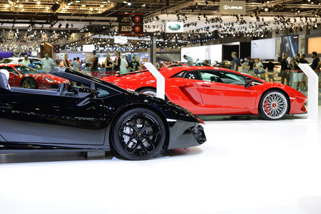 DUBAI, UAE - NOVEMBER 17: The Lamborghini Huracan Spyder  and Aventador S Coupe sportscars is on Dubai Motor Show 2017 on November 17, 2017