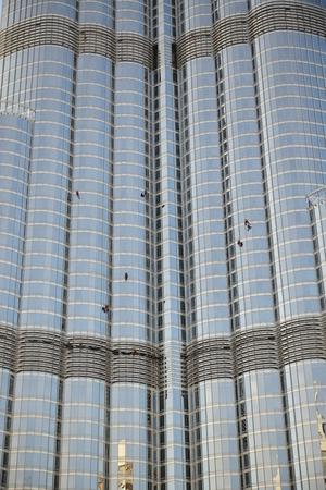 DUBAI, UAE - NOVEMBER 19: The window cleaning by workers on Burj Khalifa skyscraper. It is the world's tallest skyscraper (height 828m, 160 floors) on November 19, 2017 Stock Photo - 113620659