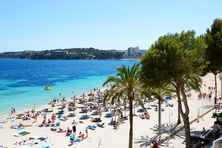 MALLORCA, SPAIN - MAY 28: The tourists enjoiying their vacation on the beach on May 28, 2015 in Mallorca, Spain. Up to 60 mln tourists is expected to visit Spain in year 2015.