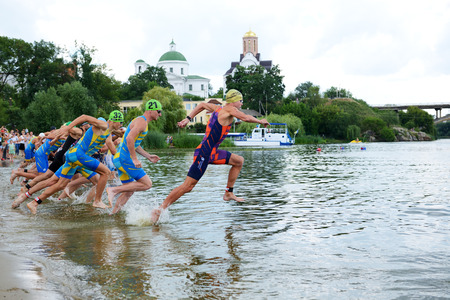 BILA TSERKVA, UKRAINE - JULY 15: The triathletes compete in swimming component  during International triathlon competition - the Cup of Bila Tserkva city and Cup of Ukraine tournament on July 15, 2018 in Bila Tserkva, Ukraine.