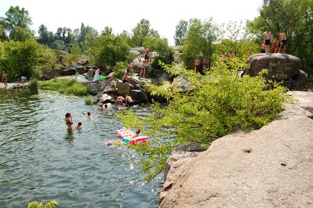 BOGUSLAV, UKRAINE - AUGUST 5: The people enjoying their holiday are near Ros river on August 5, 2018 in Boguslav, Ukraine.