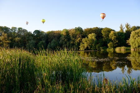 BILA TSERKVA, UKRAINE - AUGUST 23: The view on balloons are over  Olexandria Park and visitors on August 23, 2018 in Bila Tserkva, Ukraine. The balloons show is dedicated to Ukrainian Independence Day.