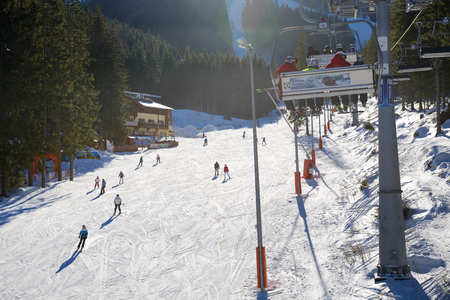 JASNA, SLOVAKIA - JANUARY 22:  The skiers are on Biela Put slope in Jasna Low Tatras. It is the largest ski resort in Slovakia with 49 km of pistes on January 22, 2017 in Jasna, Slovakia Publikacyjne