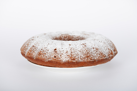 The hand-made cake with white sugar powder on it Banco de Imagens