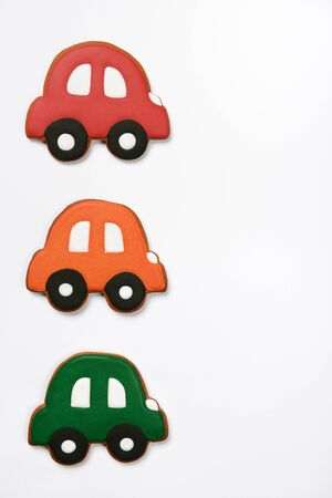 The hand-made eatable gingerbread cars on white background