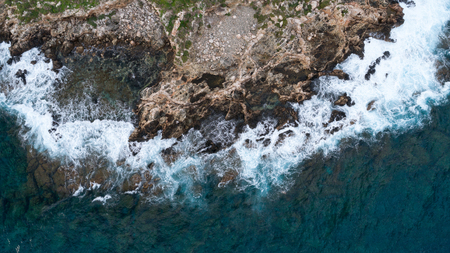 view of rough sea with rocks coast Stock Photo