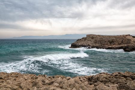 Mediterranean Sea waves breaking rocky coastline of Cyprus island